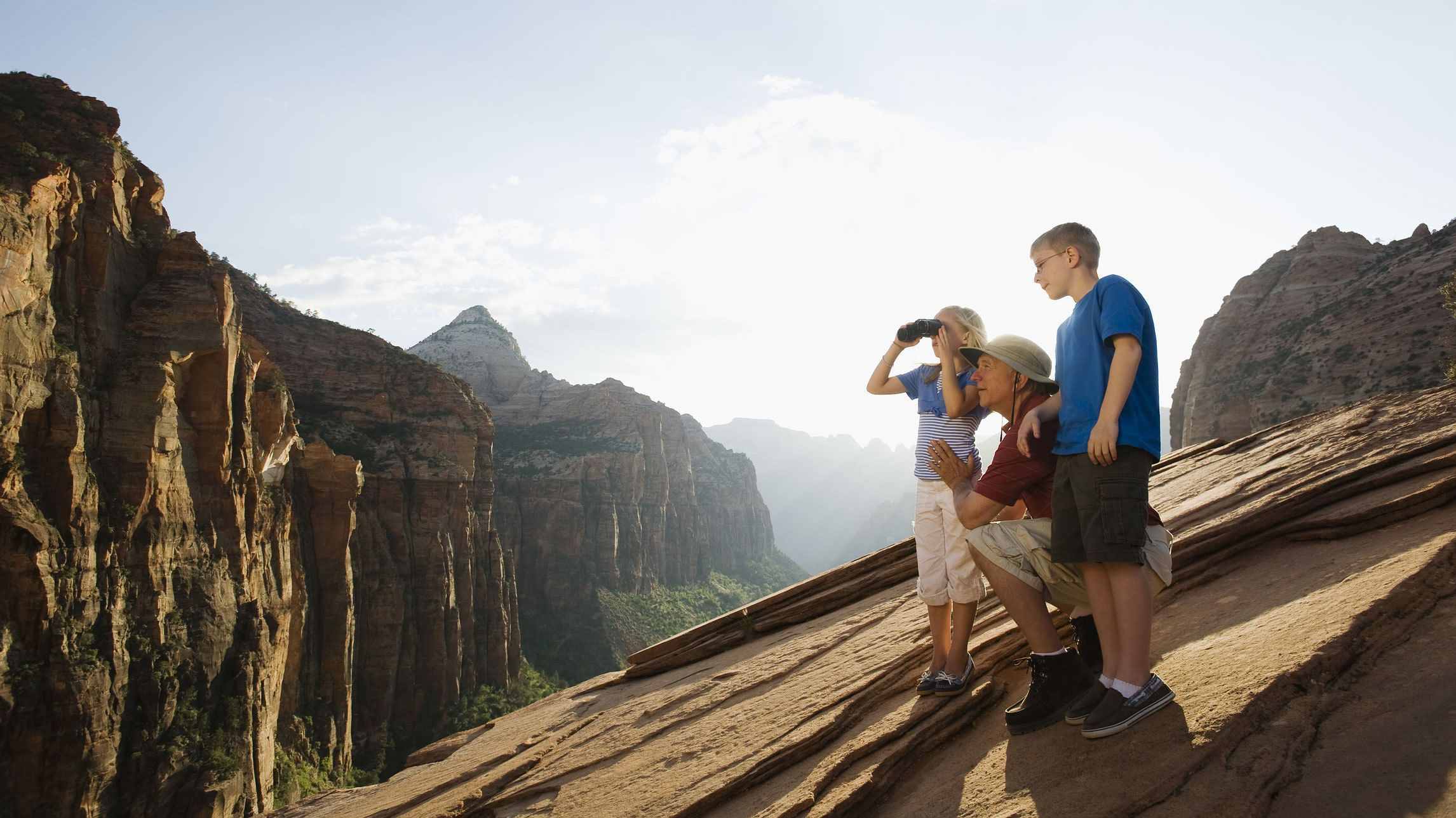Father with his young son and daughter enjoying the views within Zion National Park